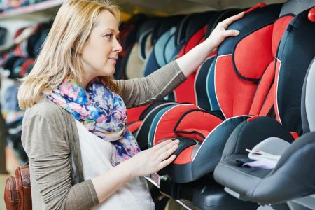 mom choosing the best all in one car seat